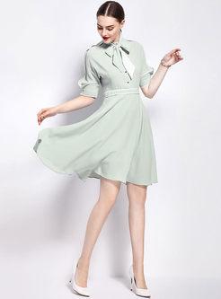 246604ba18 ... Cute Light Green Splicing Asymmetrical Skater Dress ...