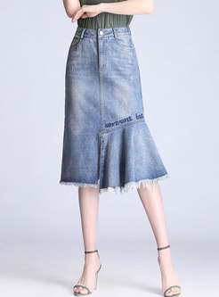 Asymmetric Washed Denim Skirt With Tied Tassel Detail