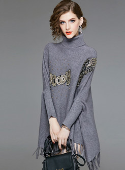 Loose Print Bat Sleeve Pullover Tassel Sweater