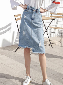 Stylish Asymmetric Holes Tassel Denim Knee-length Skirt