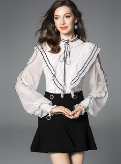 Color-blocked Standing Collar Long Sleeve Tied Blouse