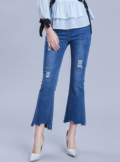 Trendy Holes Irregular Selvedge Denim Flare Pants