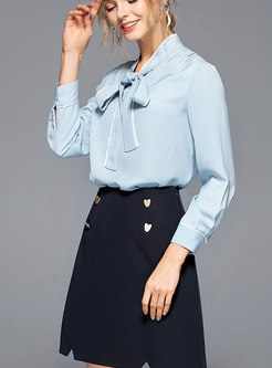 Color-blocked Stand Collar Bowknot Blouse & High Waist Mini Skirt