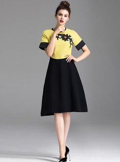 Color-blocked O-neck Embroidered Skater Dress