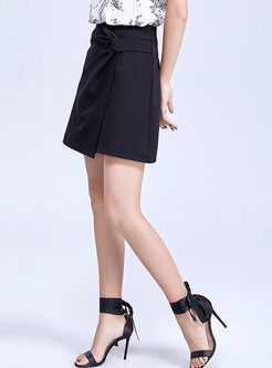 Brief Solid Color Asymmetric Mini Skirt