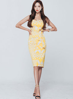Stylish Sleeveless Print Bowknot Waist Slim Dress