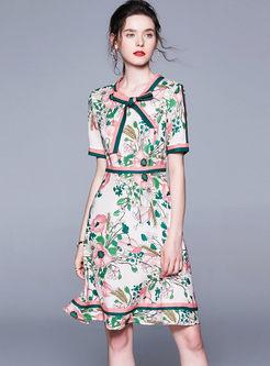 Vintage Bowknot O-neck Print Falbala Skater Dress
