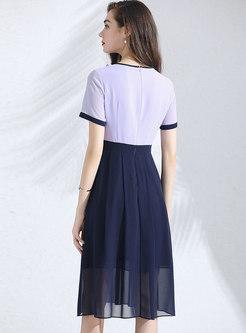 Color-blocked O-neck Falbala Splicing Big Hem Dress