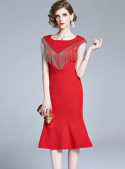 Sleeveless Tassel Peplum Midi Dress