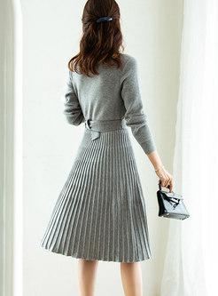V-neck Belted Knee-length Pleated Sweater Dress