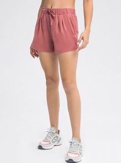 Solid Drawcord Ruched Yoga Shorts With Pockets